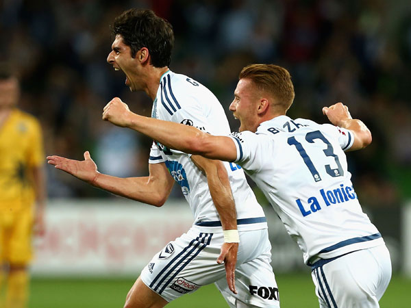 Victory midfielder Gui Finkler celebrates with teammates after scoring a goal during Melbourne's win over Central Coast Mariners. (Getty)