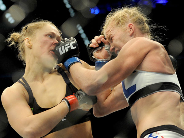 Ronda Rousey battles Holly Holm at UFC 193. (AAP)