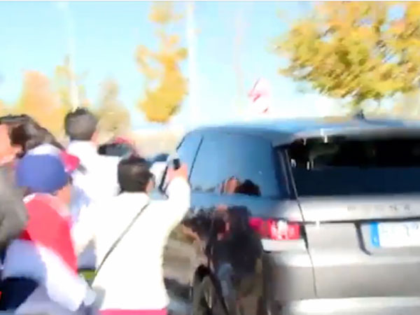Fans go into meltdown as Ronaldo drives past them following training at Real Madrid's base. (Supplied)