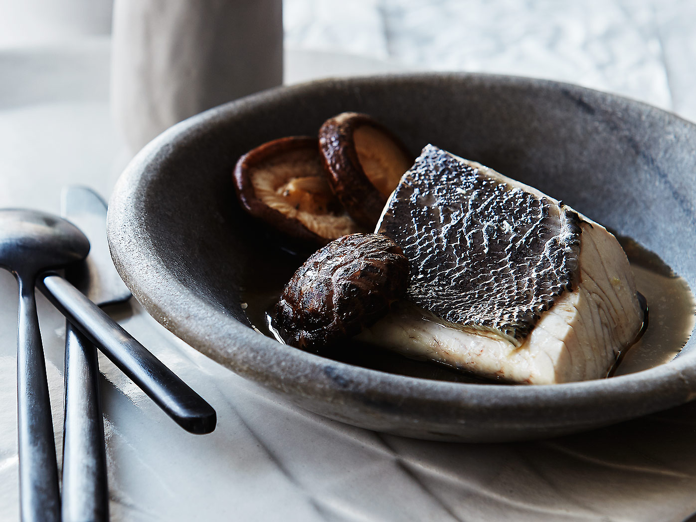 Steamed blue-eye trevalla and mushroom broth
