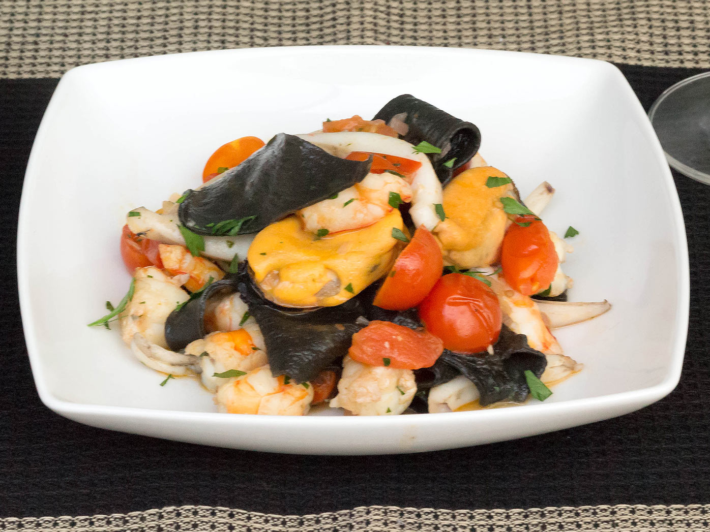 Black stracci pasta with mussels, cuttlefish and prawns