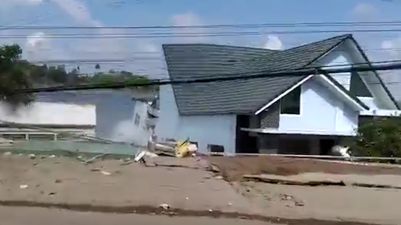 Vietnam houses collapse into river