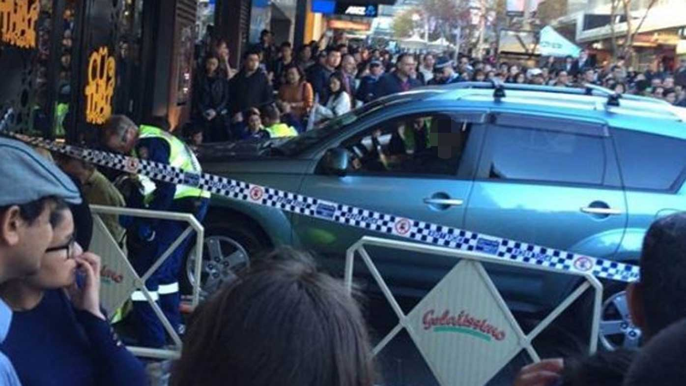 Five injured after car ploughs into crowd at Sydney shopping strip