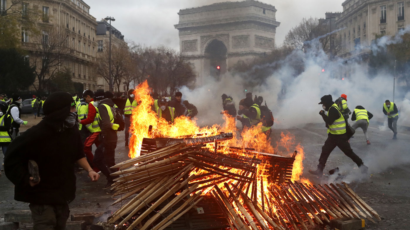 Fiery clashes on the streets of Paris see over 100 arrested
