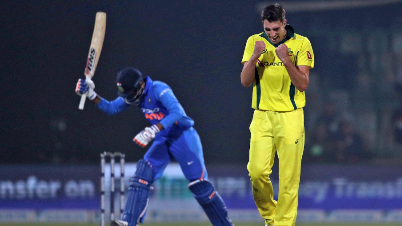 Australia's Pat Cummins celebrates the wicket of India's Kedar Jadhav during the final one day international cricket match between India and Australia.