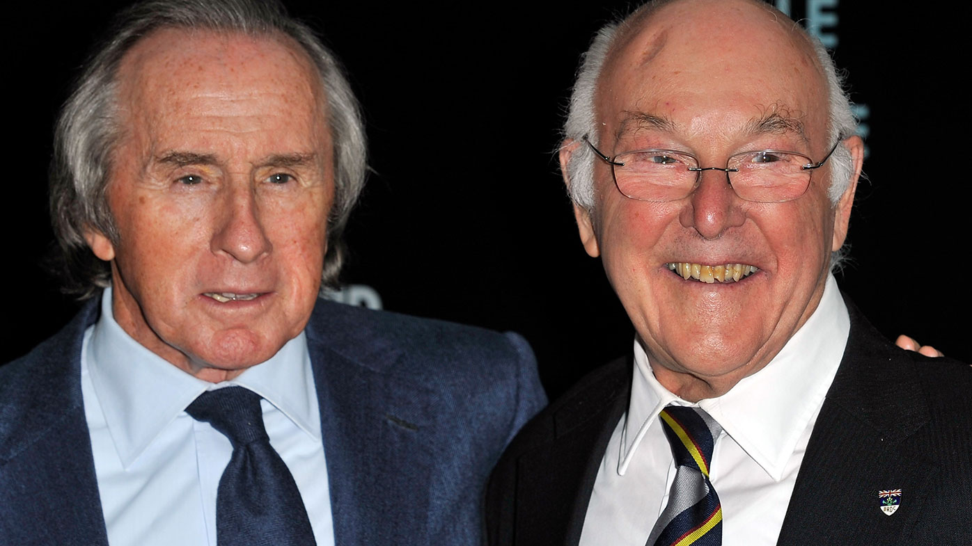Murray Walker (right) with triple world champion Jackie Stewart.