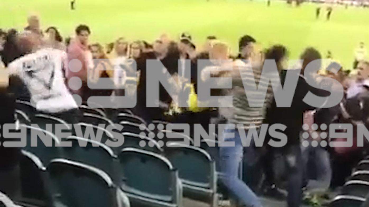 Football fan fined after wild brawl in MCG stands