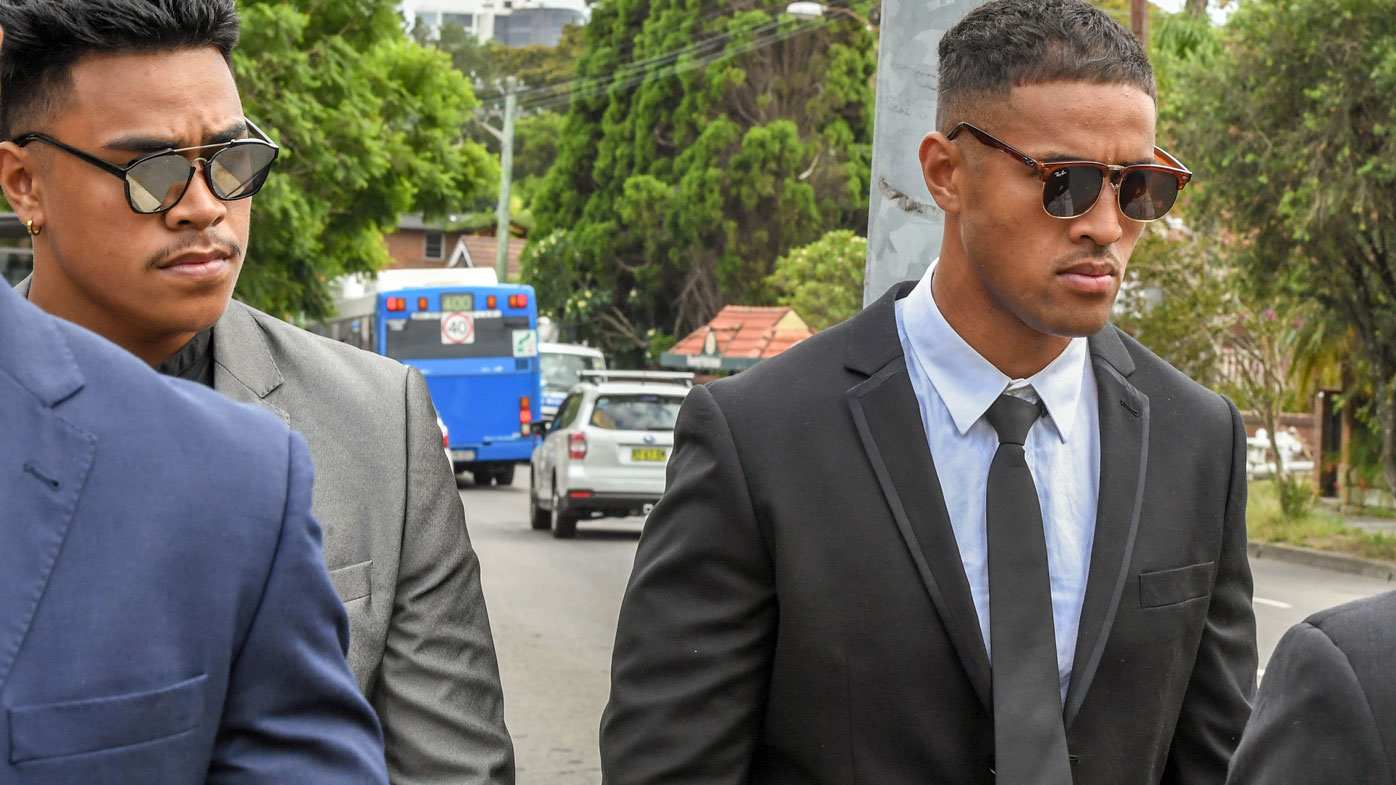 NRL player Michael Kam (right) and his younger brother Livingston Kam leave Waverly Local Court in February