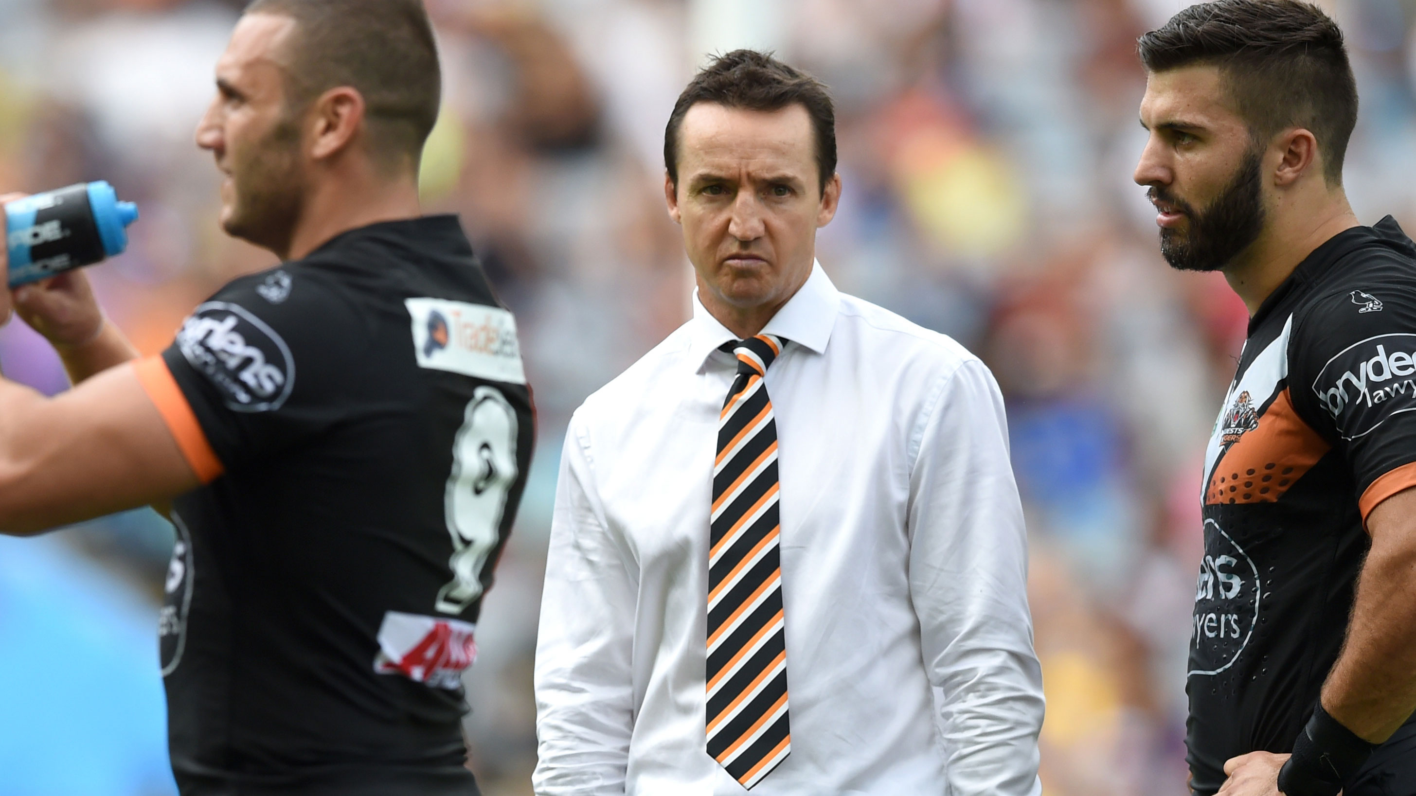 Jason Taylor (centre) and Robbie Farah (left) parted on unhappy terms at the Wests Tigers.