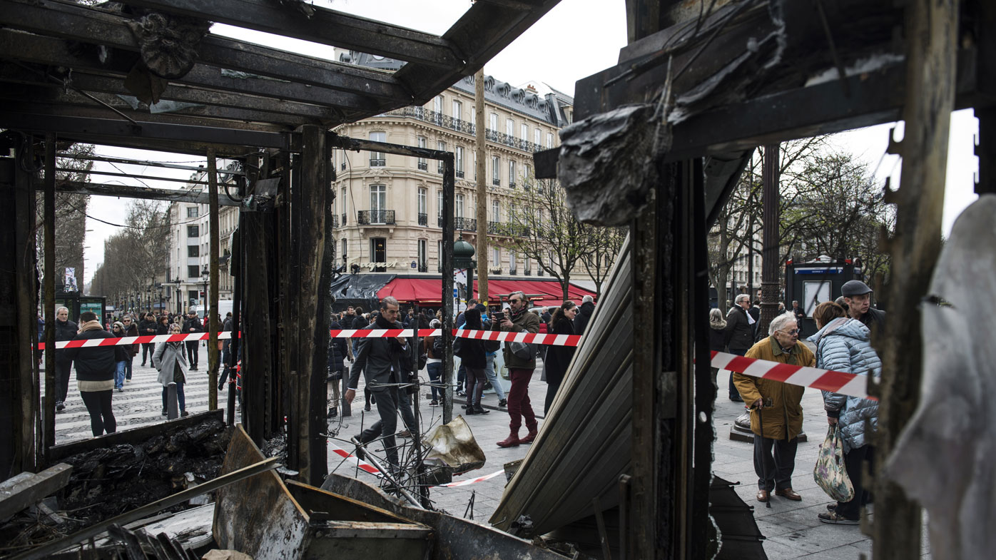 Paris begins clean up after fiery protests