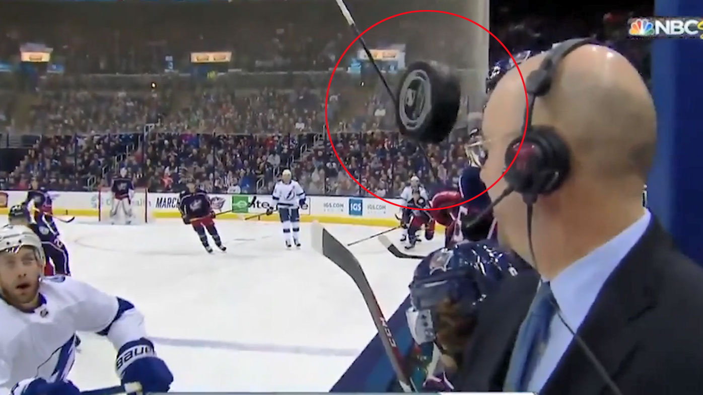 Ice hockey commentator Pierre McGuire's lucky escape from puck