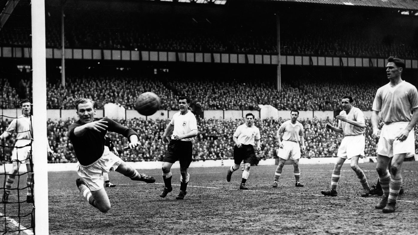 Manchester City's goalkeeper (once a German prisoner of war in Britain) acrobatically tips the ball around the post from a Tottenham Hotspur shot