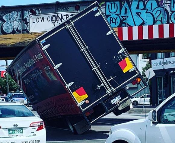 Truck wedged under CBD overpass