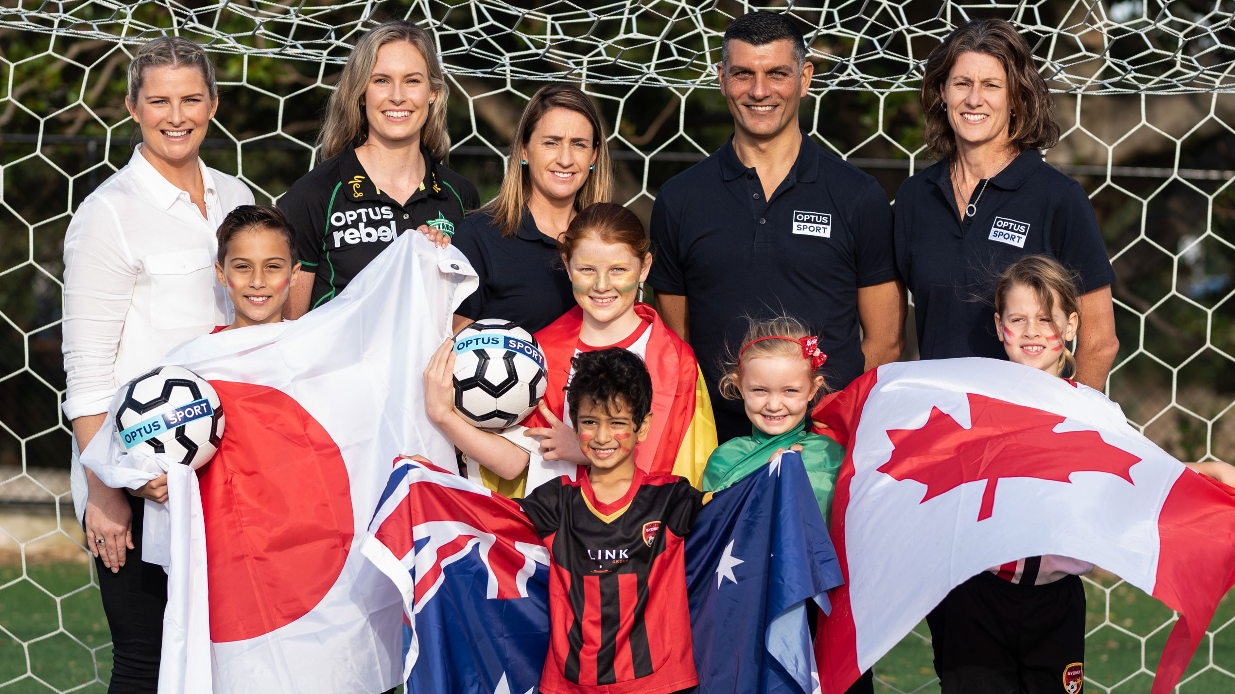 Olympic swimmer Leisel Jones and WBBL cricketer Holly Ferling join football legends Heather Garriock, John Aloisi and Cheryl Salisbury at an Optus Sport announcement with kids from North Sydney United.