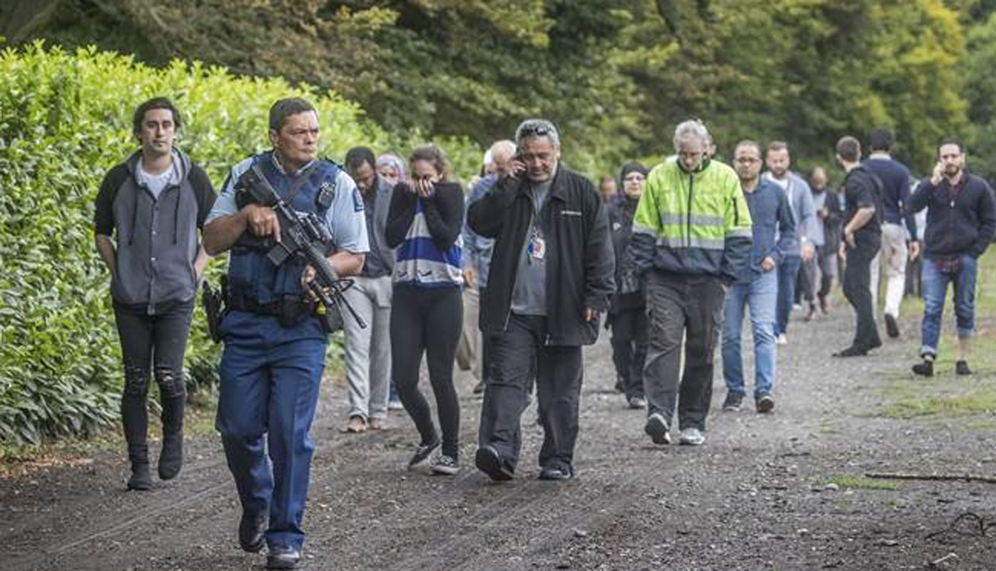 Christchurch mosque shooting: Armed police walk people to safety after deadly attacks