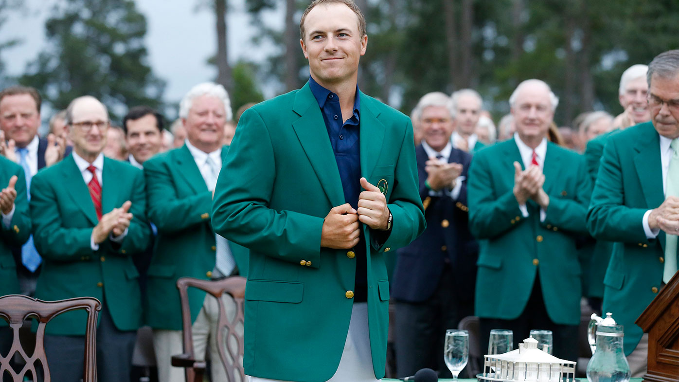 Jordan Spieth dons the green jacket after winning the 2015 Masters.