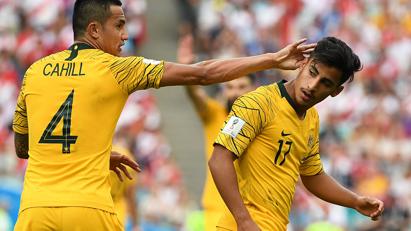 Australia's Tim Cahill and Daniel Arzani during their final FIFA World Cup group match against Peru