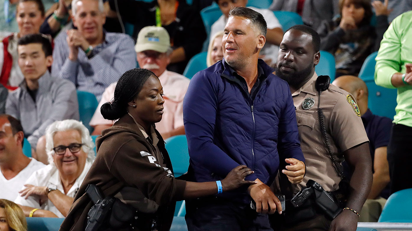 A spectator is ejected after a running battle with Nick Kyrgios in Miami.