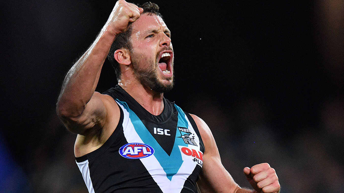 Travis Boak of the Power reacts after scoring a goal