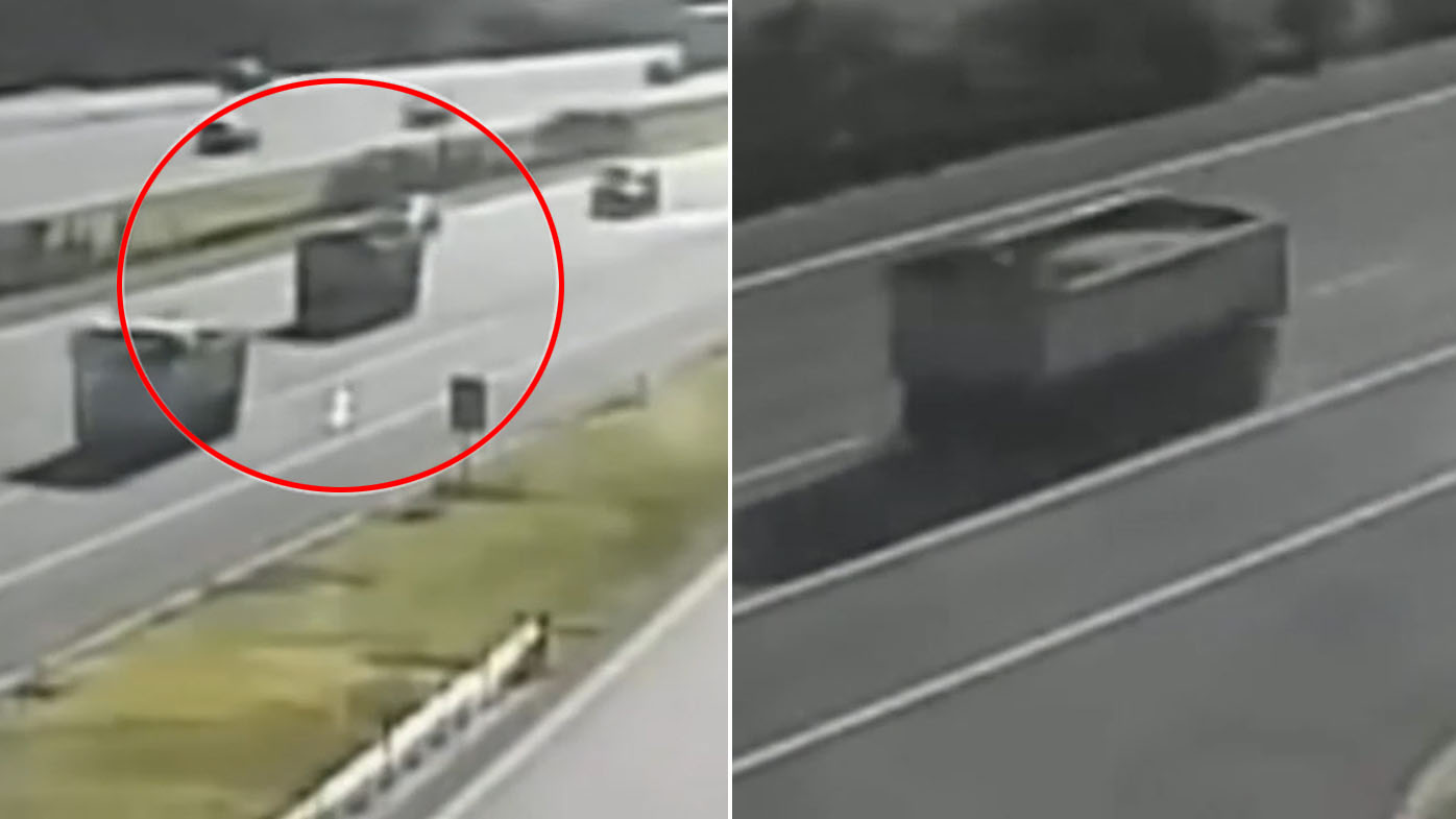 Frightening close call as runaway trailer travels down busy road