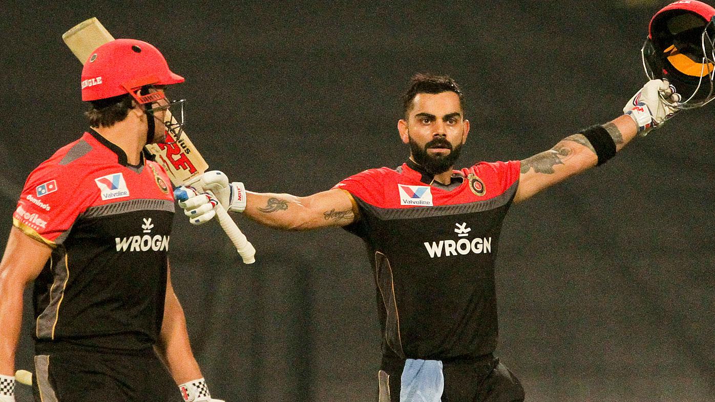 Royal Challengers Bangalore's Virat Kohli celebrates after scoring a century