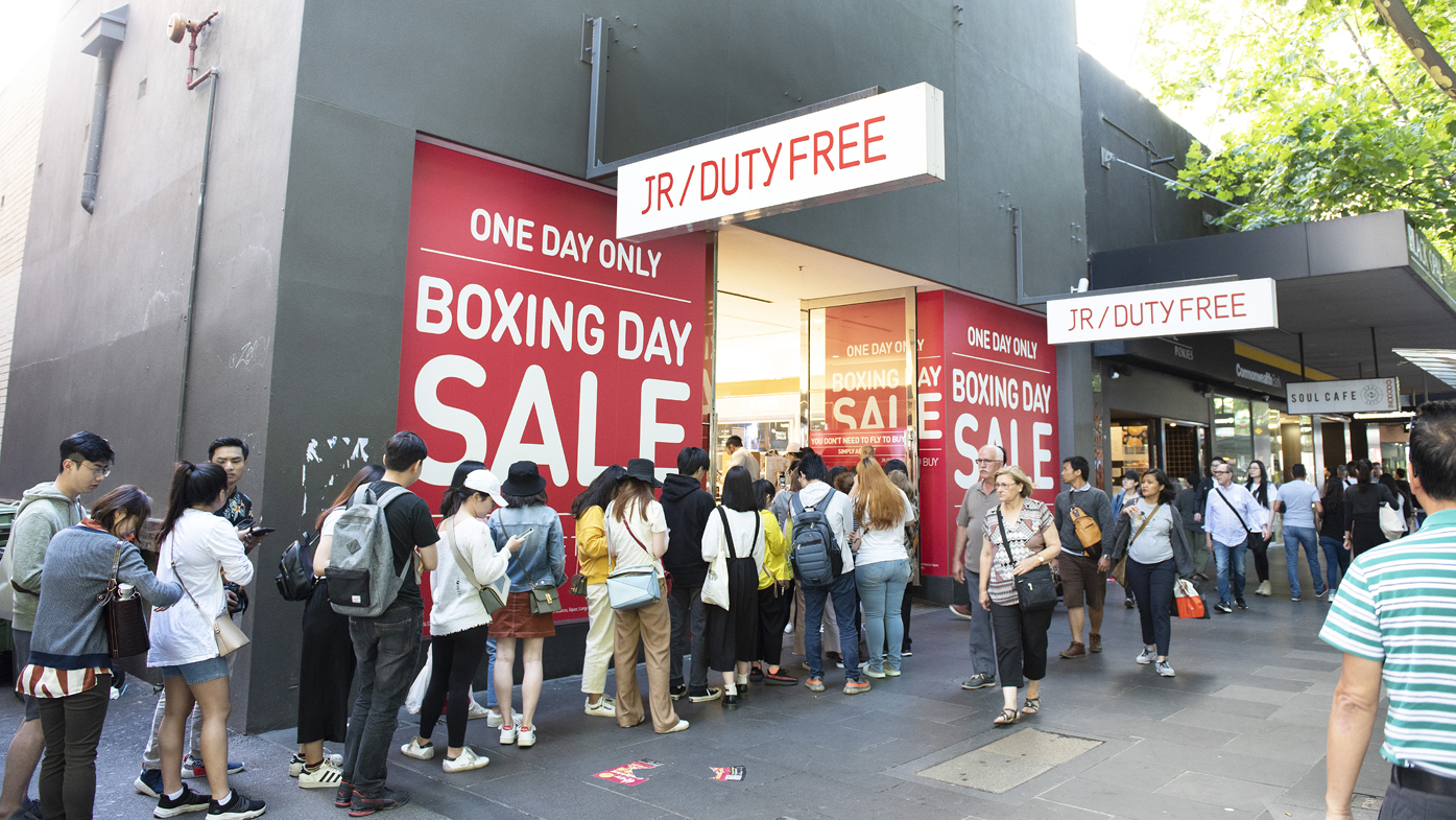 Shoppers line up outside retail store in Melbourne