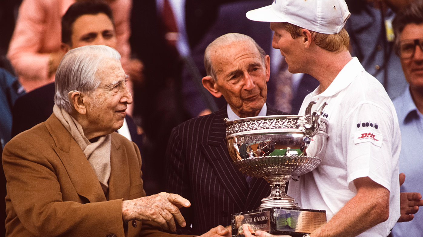 Jim Courier greets Rene Lacoste at the French Open
