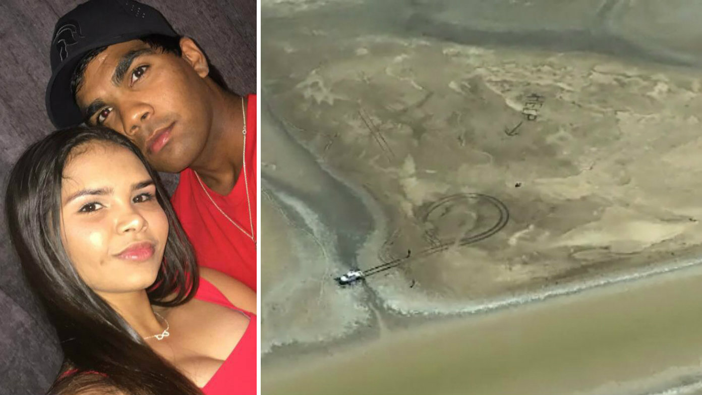 Couple stuck in croc-infested swamp overnight rescued after writing 'HELP' in mud