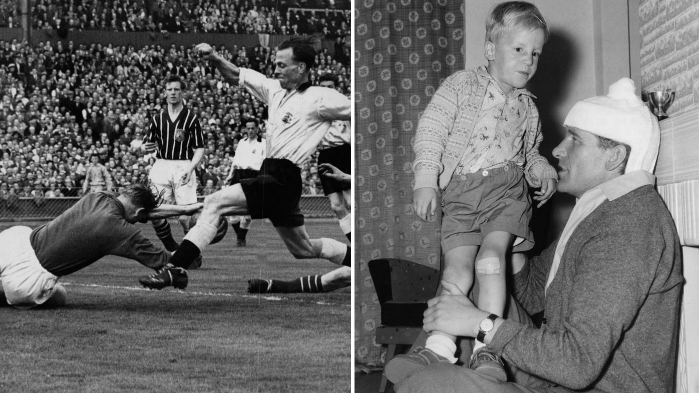 Manchester City goalkeeper Bert Trautmann dives at the feet of Birmingham's Murphy which broke his neck at the 1956 FA Cup final.