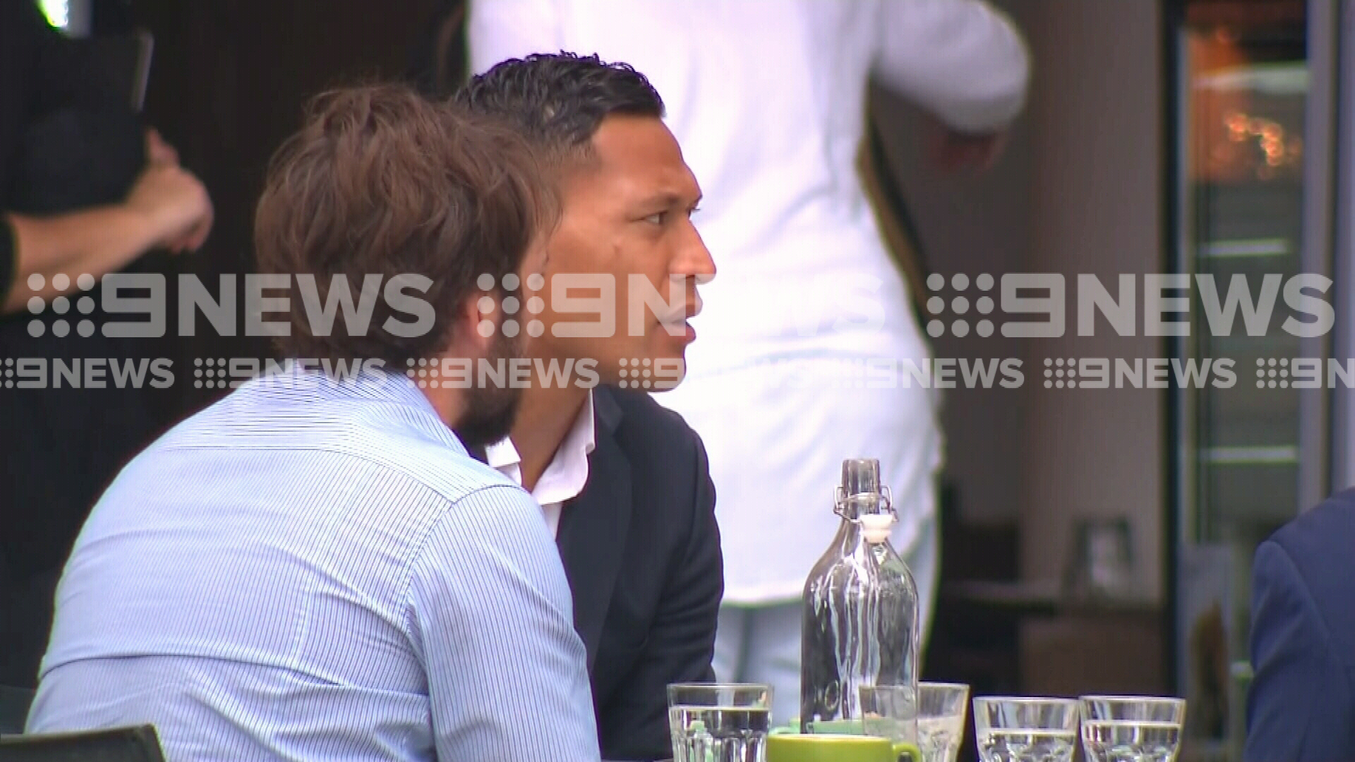 Israel Folau filmed at a cafe.