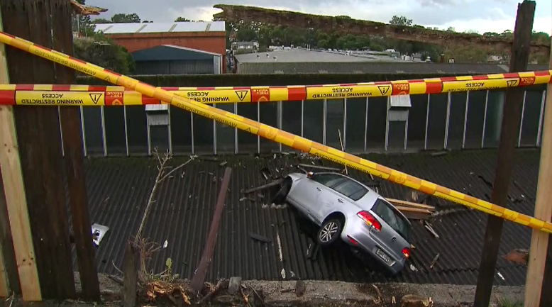 Recovery operation under way after car crashes into Leichhardt roof