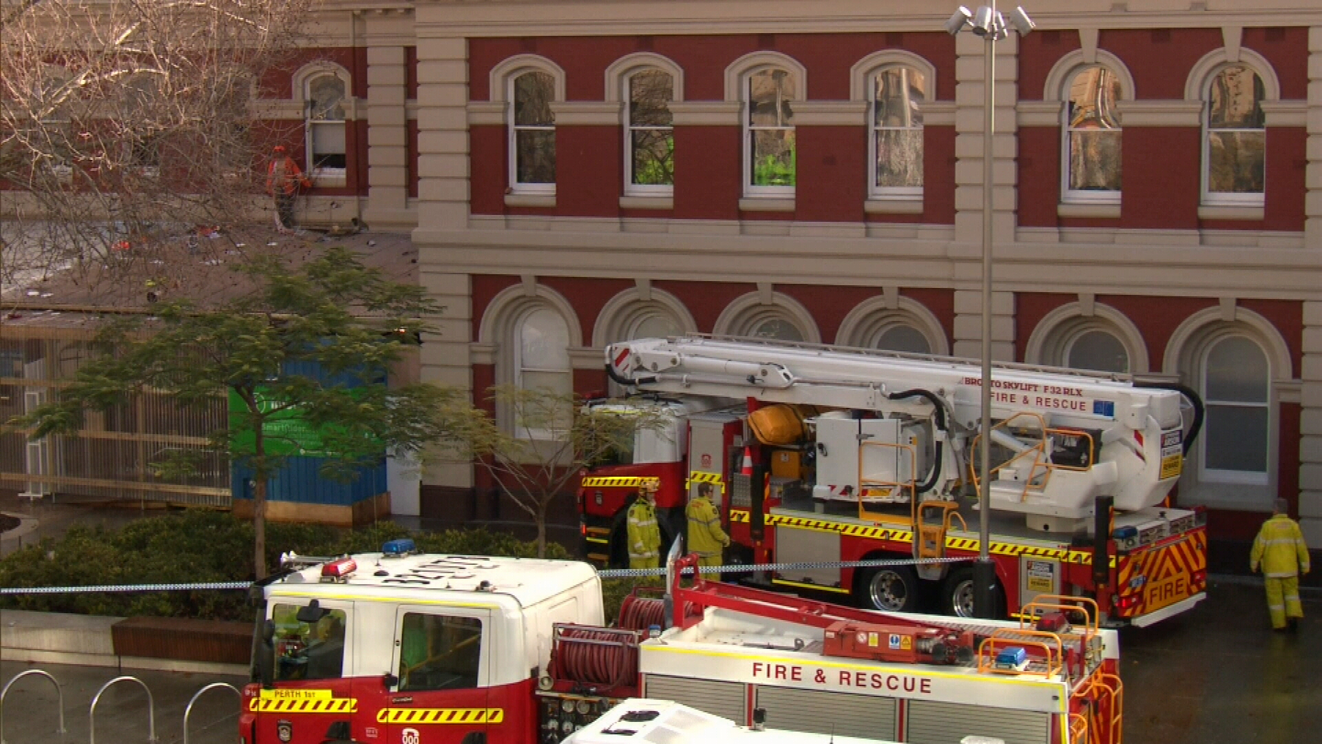 Naked man on train station roof puts Perth street in lockdown