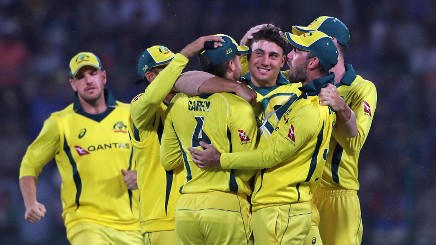 Australia's players celebrate the dismissal of India's captain Virat Kohli.