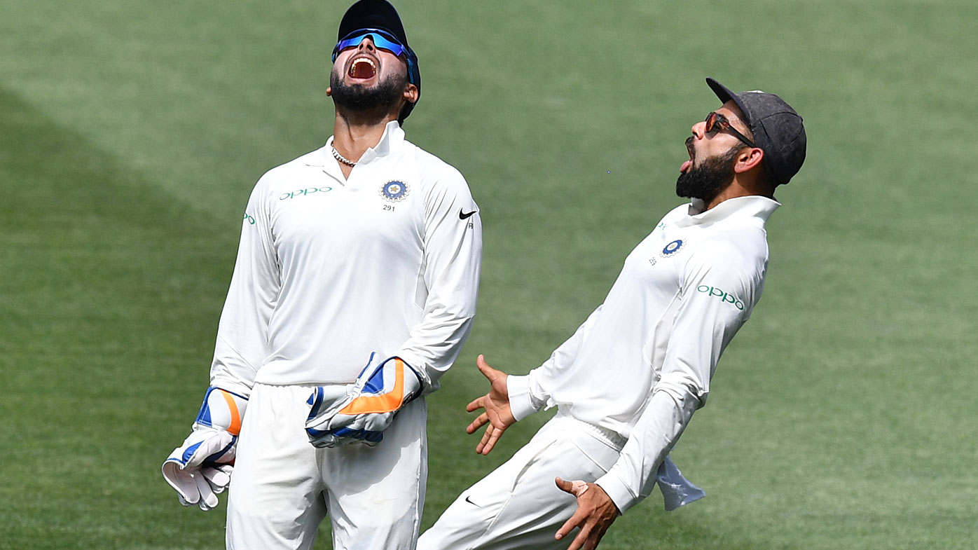 Pant and Kohli celebrate a wicket