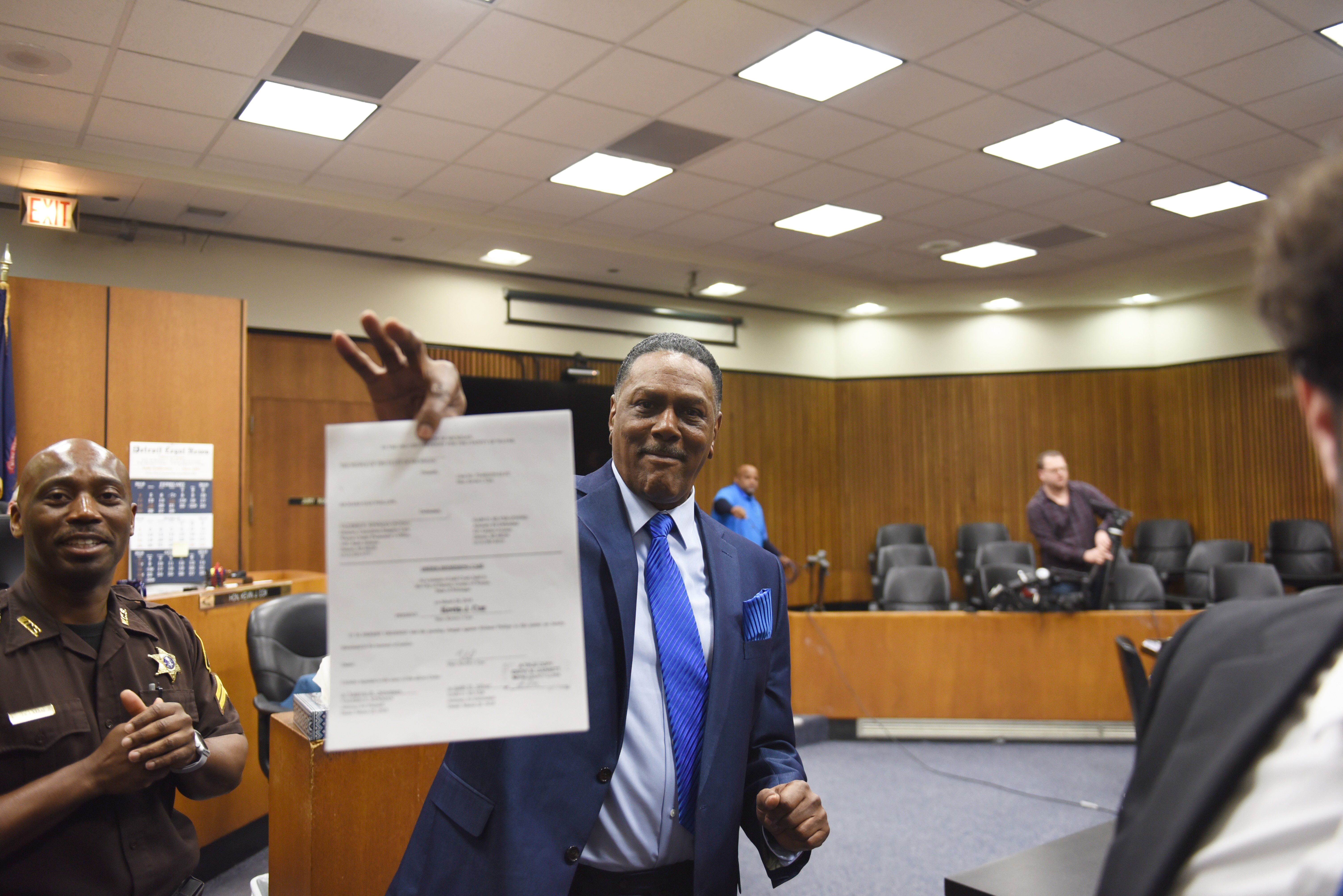 Richard Phillips shows his order of dismissal of homicide charges against him in Judge Kevin Cox's courtroom at the Frank Murphy Hall of Justice in Detroit on Wednesday, March 28, 2018.