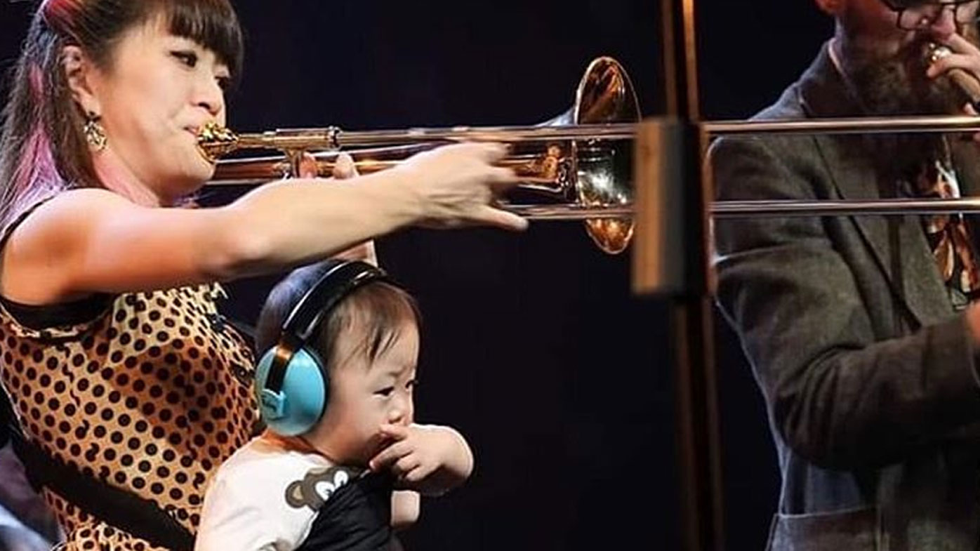 Jazz musician performs with her son in her arms while on tour when there's no babysitter