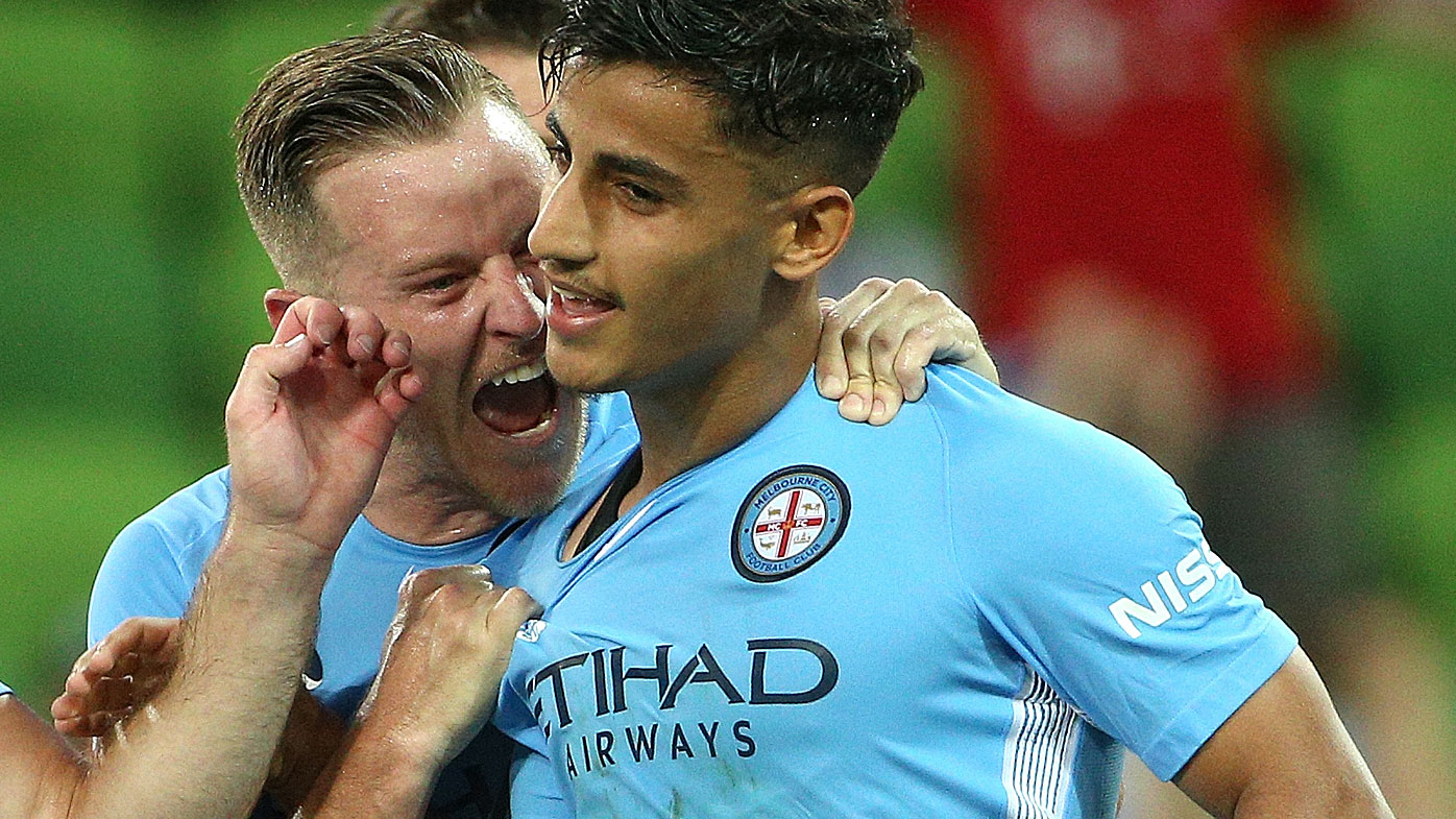 Daniel Arzani at Melbourne City is congratulated by teammate Scott Jamieson after scoring