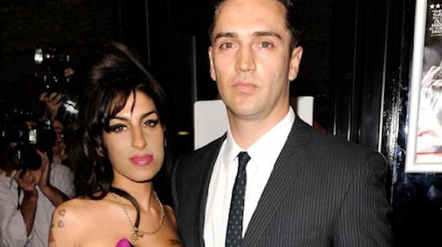 Amy Winehouse's ex-boyfriend Reg Traviss has been accused of raping sleeping women