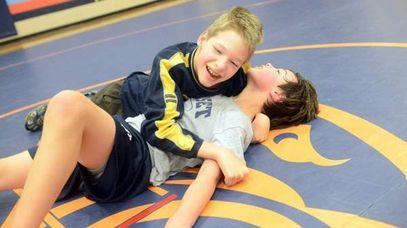 Jared Stevens (left) wrestles with Eli Copeland during practice at Sunset Middle School.