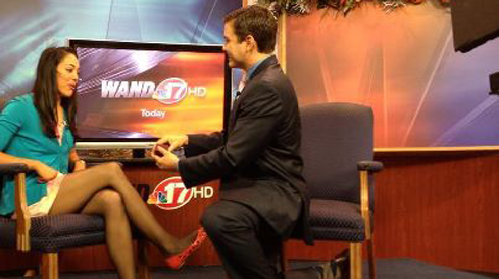 News anchor Mark Rivera proposes to Alissa Groeninger on air yesterday.