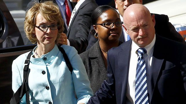 Gabrielle Giffords and her husband Mark Kelly. (AAP)