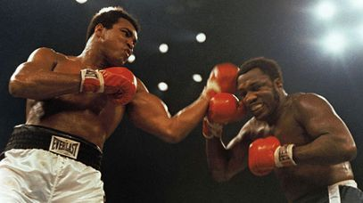 Muhammad Ali lands a blow against Joe Frazier in 1974.