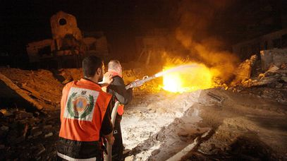 Palestinian firefighters tackle a blaze at a destroyed Hamas site after an Israeli air strike hit an area south of Gaza City.