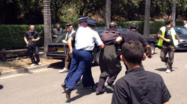A suspected extremist being arrested by police.
