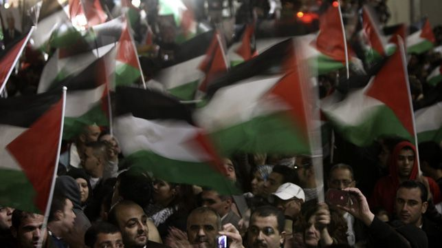 Palestinians wave flags as they celebrate the UN's vote to recognise Palestine as a non-member observer state.