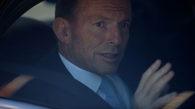 Prime Minister Tony Abbott leaves in a Holden car after a visit to the Australian War Memorial in October. (AAP)