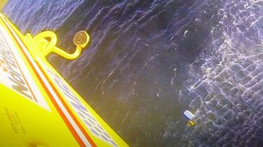 An image from the Westpac Life Saver Rescue Helicopter showing the rescue of two men who spent the night in the water after their boat overturned. (Supplied)