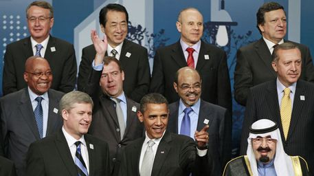 President Barack Obama (front centre) and Wayne Swan (back left) at the 2010 G20 summit. (AAP)