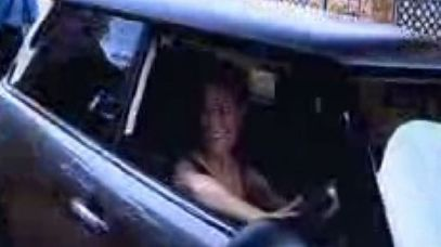 A video still showing Reeva Steenkamp looking happy as she pulled up at the home of Oscar Pistorius.