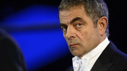 Comedian Rowan Atkinson performs during the opening ceremony of the London 2012 Olympic Games.